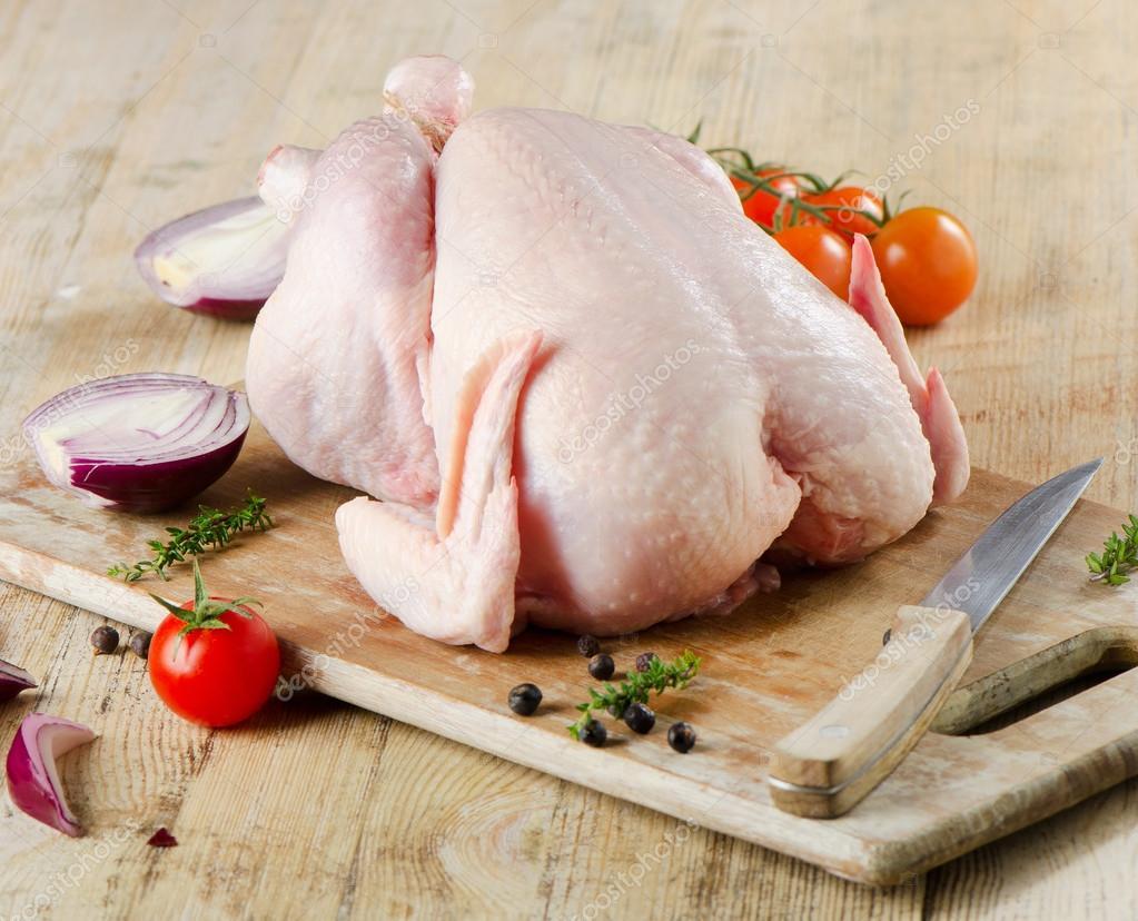 depositphotos_40292275-stock-photo-whole-raw-chicken-on-a
