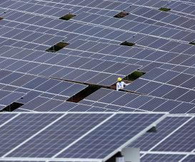 --FILE--A Chinese worker checks solar panels at a photovoltaic power station in Weining Yi, Hui and Miao Autonomous County, southwest China's Guizhou province, 30 June 2016.  China's epic solar binge accelerated in the first six months of 2016, as the country added more than 20 gigawatts of new solar installations. That's nearly three times as much as the same period in 2015, and is more than the total installed capacity of all but Germany, Japan, and the United States. But signs are growing that the boom is starting to fade. Investment firm Macquarie Capital said in July that many of the solar farms built in 2016 were hastily completed to meet the deadline of July 1, when government subsidies for new solar were cut. Further cuts are expected in 2017 as the government tries to rein in runaway development. China now has around 63 gigawatts of solar power capacity, more than any other country. And wind, solar, nuclear, and hydro projects continue to be built out even though energy demand in China is nearly flat.
