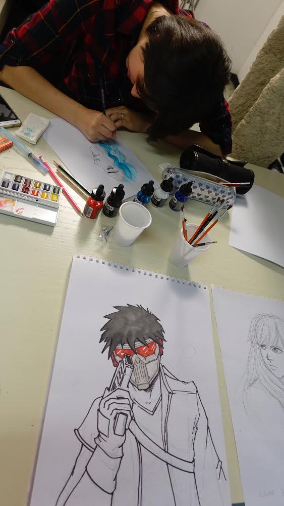 米蘭藝術學校學生向遊人示範繪圖實況