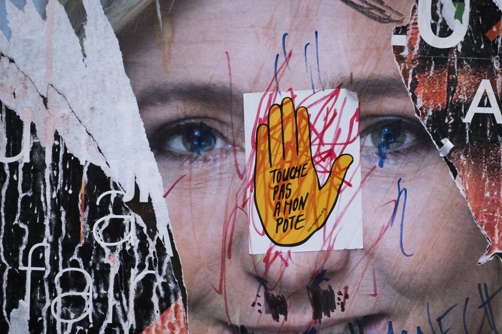 A picture taken in Paris on May 2, 2017 shows a vandalised campaign poster of French presidential election candidate for the far-right Front National (FN) party Marine Le Pen ahead of the second and final round of the French presidential election on May 7.   / AFP PHOTO / JOEL SAGET