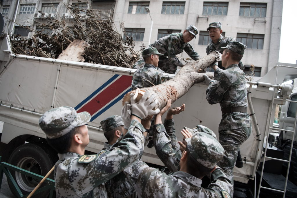 PLA soldiers work around clock to clean up Macao streets
