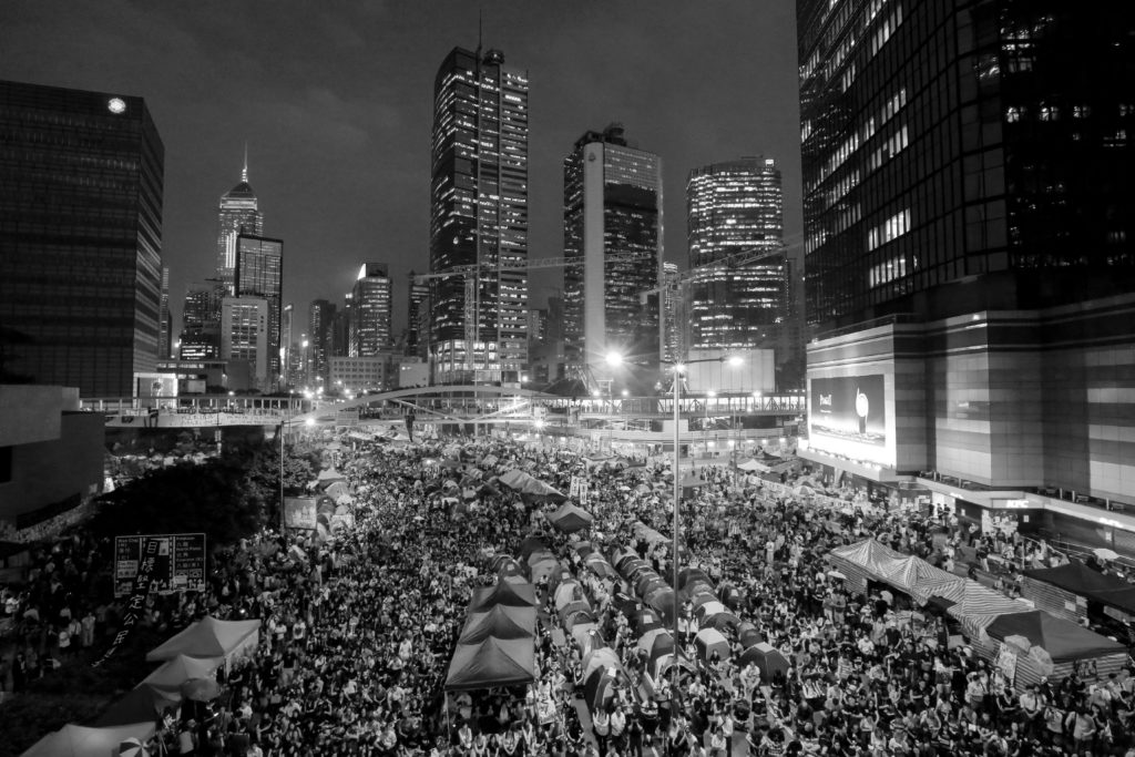 Protesters fill the streets as tens of thousands come to the main protest site one month after the Hong Kong police used tear gas to disperse protesters October 28, 2014 in Hong Kong, Hong Kong. A peaceful safe atmosphere remains at the massive protest site as artists freely express themselves and families bring their children to experience the Umbrella Revolution. (Photo by Guillaume Payen/NurPhoto)