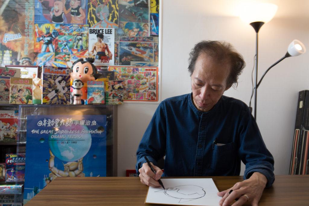 「手塚達人」盧子英即席繪畫大師最為人熟悉的漫畫主角小飛俠阿童木。