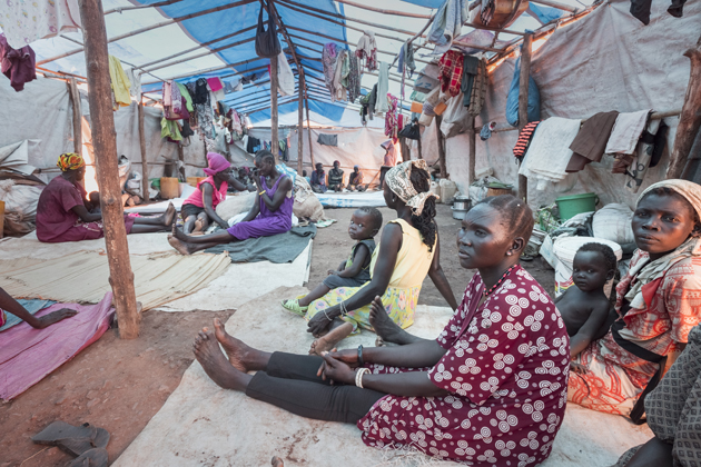 """""""We want peace."""" Internally displaced women and children are photographed in their shelter at POC3 camp in Juba during a visit by the United Nations High Commissioner for Refugees Filippo Grandi. ; The refugee crisis in South Sudan has displaced almost 4 million people since the conflict began in December 2013. In July 2016, the disastrous breakdown of peace efforts in South Sudan contributed to a mass outflow of people fleeing for their lives. By June 2017, nearly 1.87 million people had fled the country and a further 1.9 million were internally displaced. Two-thirds are under the age of 18 and many of them have witnessed brutal violence, fleeing their villages when armed groups burned down their houses and killed their neighbours. During a three-day visit to the world's fastest growing displacement crisis, UNHCR chief Filippo Grandi said peace is the only lasting solution for the millions of displaced."""