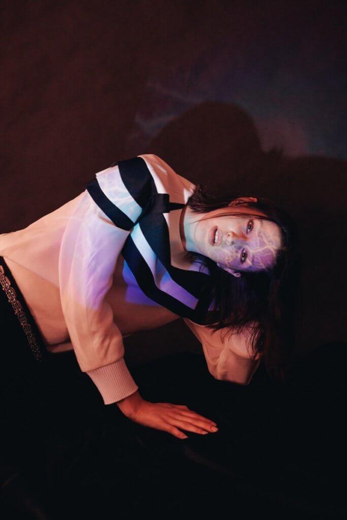 Sweater $27,100, skirt $30,500 from Louis Vuitton