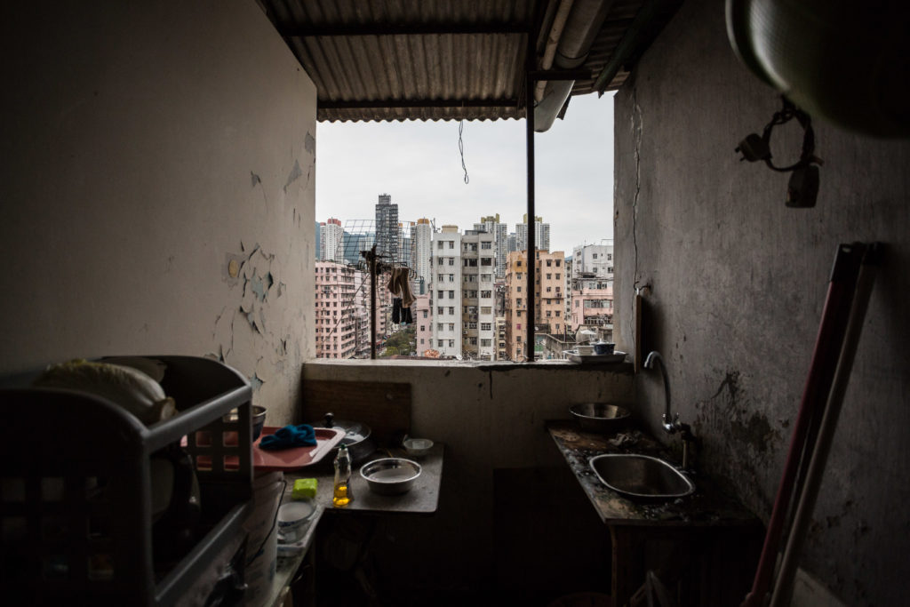 """This picture taken on April 18, 2016 shows the view from the communal outdoor kitchen used by tenants living in """"cubicle"""" flats built within a subdivided """"rooftop house"""" on the roof of a ten storey building in the Kowloon district of Hong Kong. (Photo by Anthony WALLACE / AFP) / To go with """"HongKong-social-politics-homeless"""" FEATURE by Laura Mannering"""