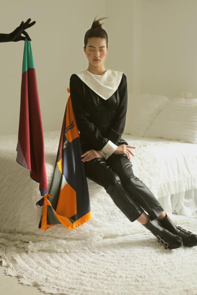 Jumpsuit $tbc by Fendi, Shoes $tbc by Miu Miu Scarf (Orange) $3,600 and (Burgundy and Green) $2,700 by Hermès, Gloves $3,800 by Balenciaga