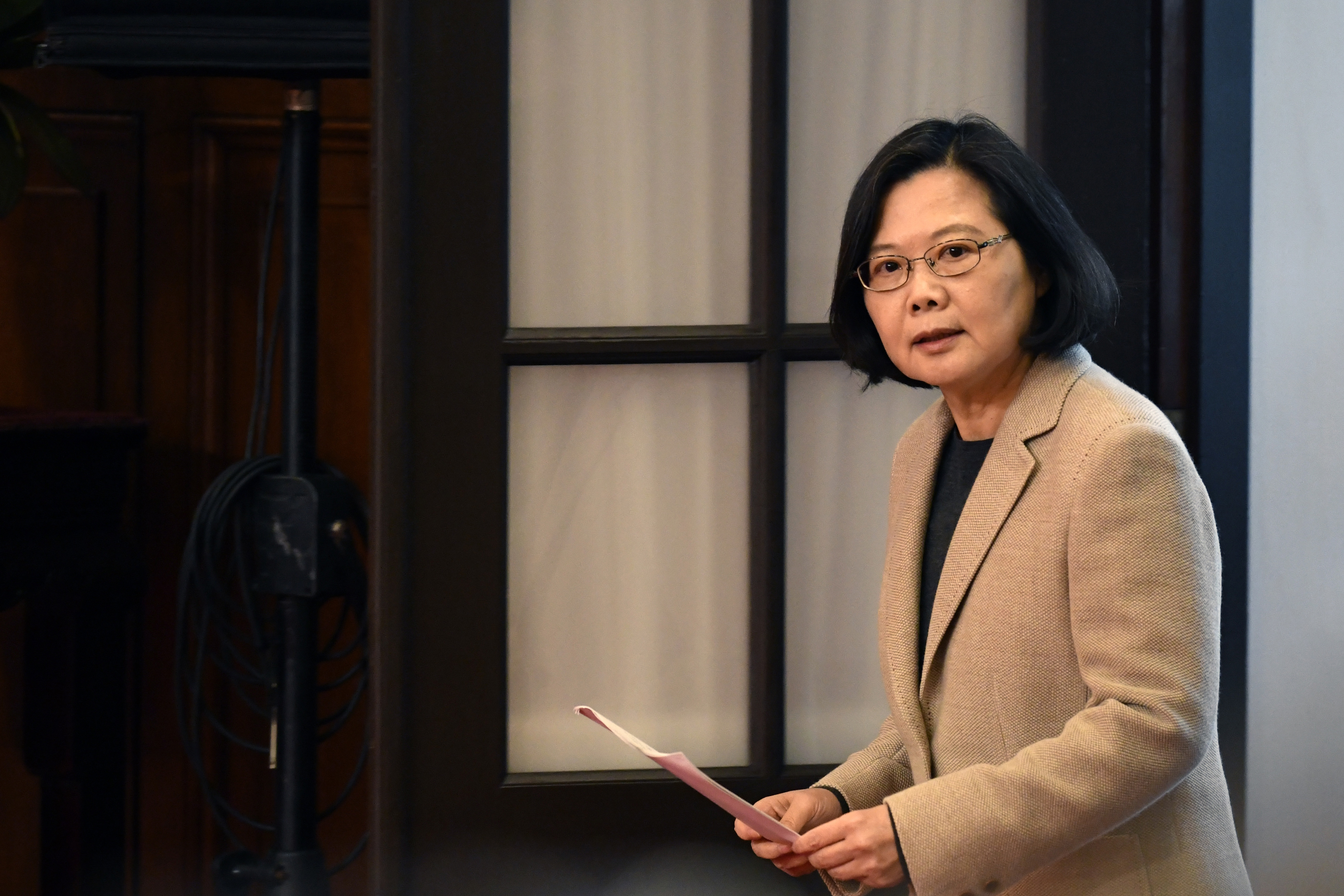 Taiwan's President Tsai Ing-wen arrives for a press conference at the Presidential Palace after the national flag raising ceremony in Taipei on January 1, 2019. (Photo by Sam YEH / AFP)