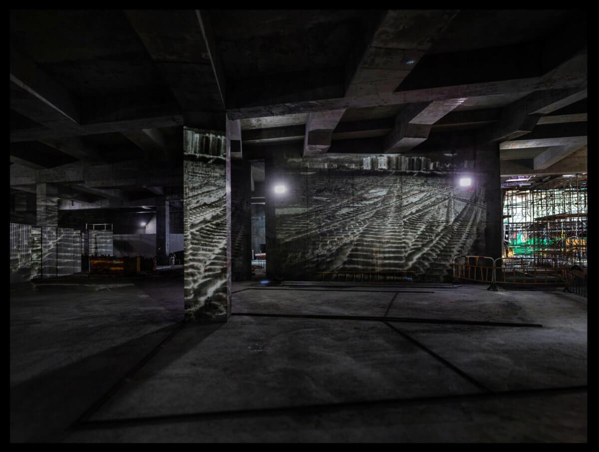 2015年,謝至德獲委約拍攝與戲曲中心誕生的有關作品,他把九十年代西九填海區照片,投影於工地的水泥牆上, 讓過去與未來在空間作為一場對話,亦為自己的攝影計劃作一終結。