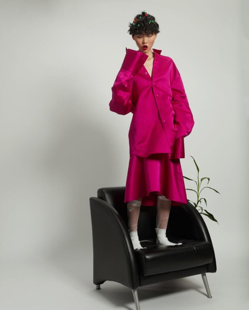 Shirt $16,200, Skirt $16,200 both from Balenciga  Socks from PRADA $1,350 Filp Floos from Maison Margiela $7,920