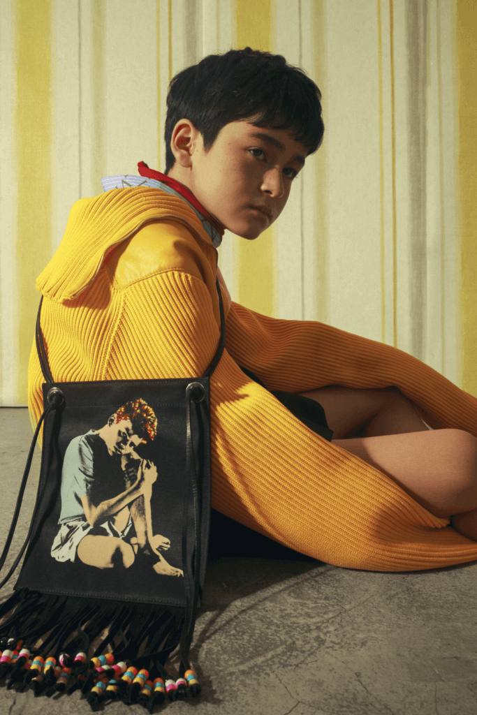 Sweater $18,050, Top $3,950, Shorts $9,650 All by Prada Shirt $7,400 by Valentino Bag $3,635 by JW Anderson