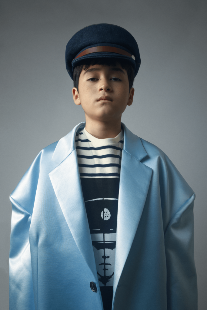 Coat $28,999 by Raf Simons from I.T T-shirt $2,380, Cap $2,380 All by JW Anderson