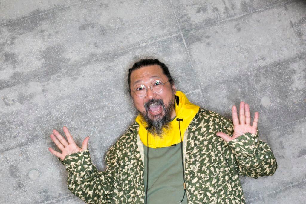村上隆,1962年生,日本藝術家,超扁平藝術運動創始人,1996年創辦HIROPON工廠,即現時藝術管理公司Kaikai Kiki的前身。作品曾於布魯克林博物館、凡爾賽宮、芝加哥當代藝術博物館、波士頓美術館和莫斯科車庫當代藝術博物館、洛杉磯當代藝術館等展出。