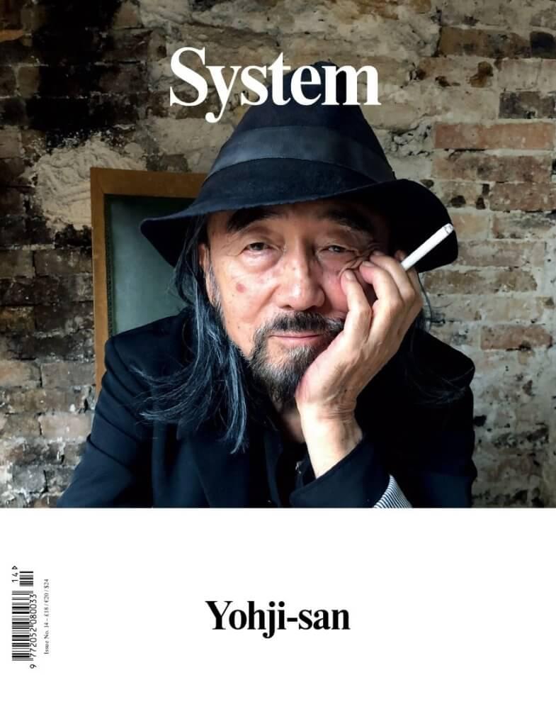 東洋大師山本耀司(Yohji Yamamoto)手持一根香煙、雙眼迷濛的成為《System》封面主角。