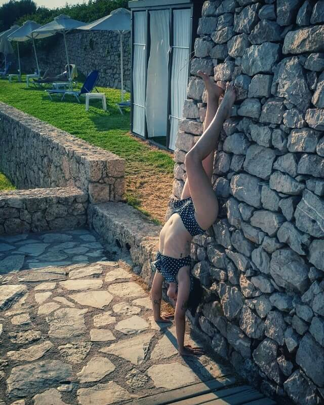 "Mara Gyparaki, my friend and a fellow ballerina, in her lovely handstand. ""Sometimes you have to let life turn you upside down, so you can learn how to live the right side up."" (Instagram @mara_gyp)"
