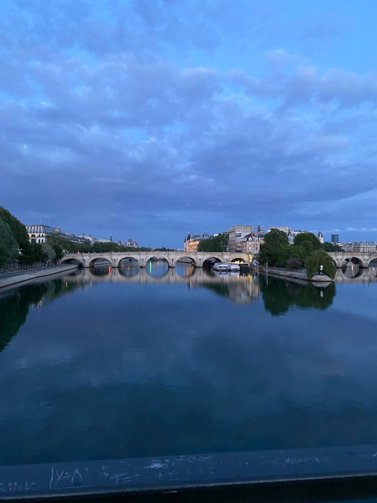 Pont Neuf, a foot bridge over the Seine river, at sunset.