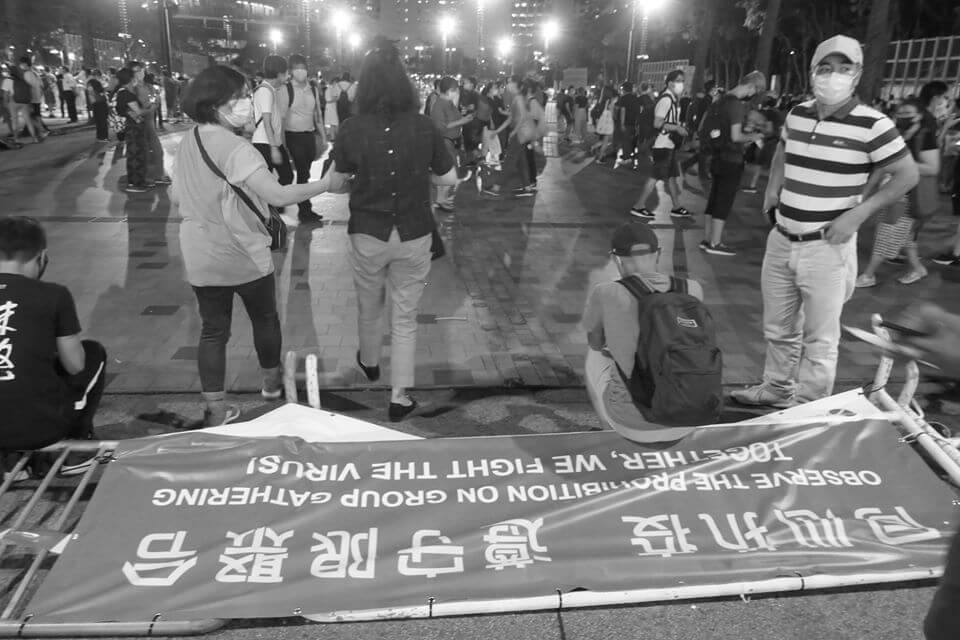 People gathered to remember the Tiananmen massacre, despite an official police ban using Covid-19 social gathering restrictions on this year's candlelight vigil, Victoria Park, Causeway Bay, Hong Kong, 4 June 2020 (photograph: John Batten)