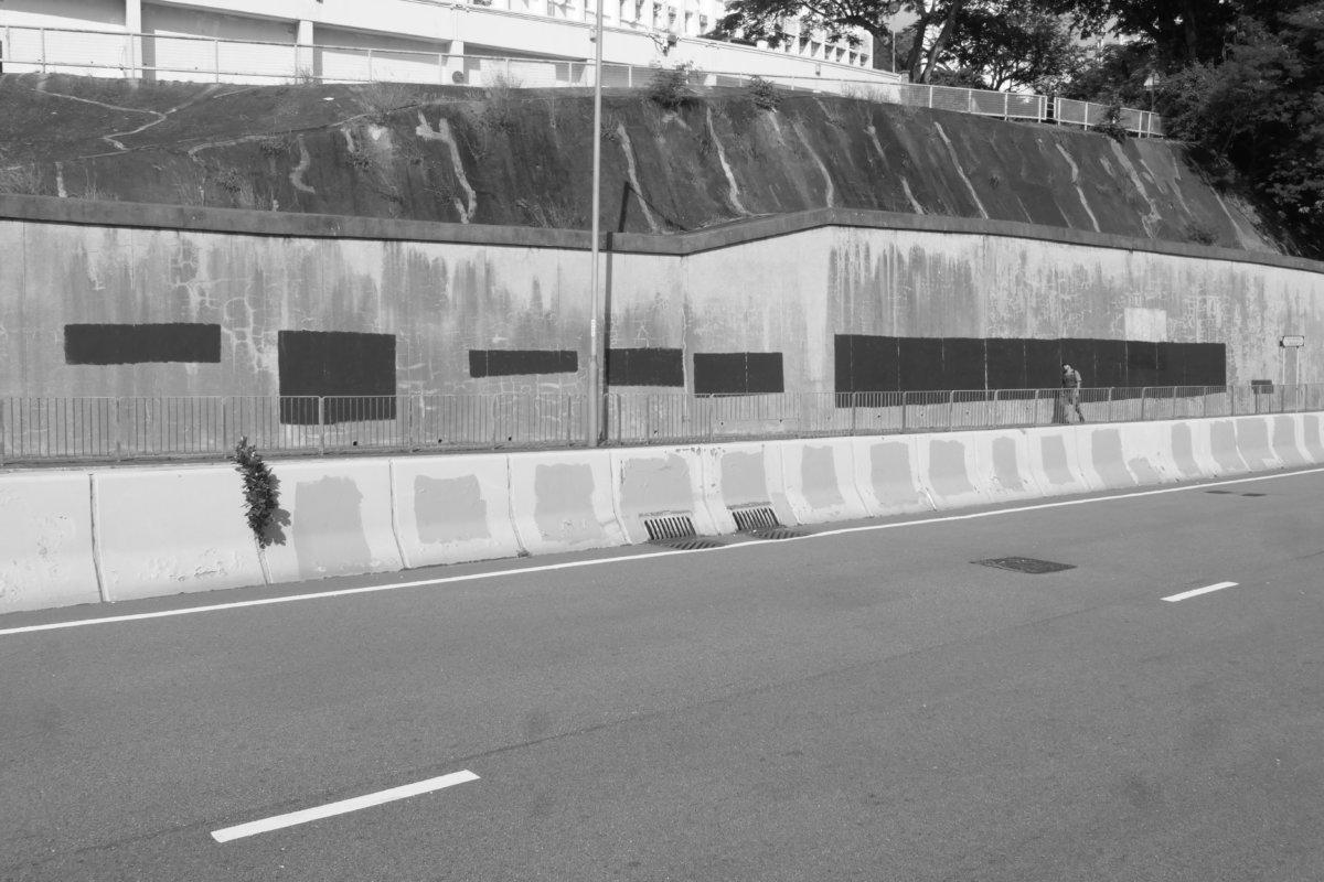 Deleted graffiti, retaining wall, Pokfulam, Hong Kong (photo: John Batten)