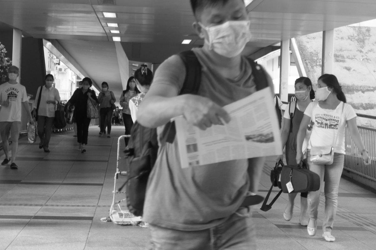 Falun Gong canvassing on pedestrian overpass, Wan Chai, Hong Kong. (photo: John Batten)