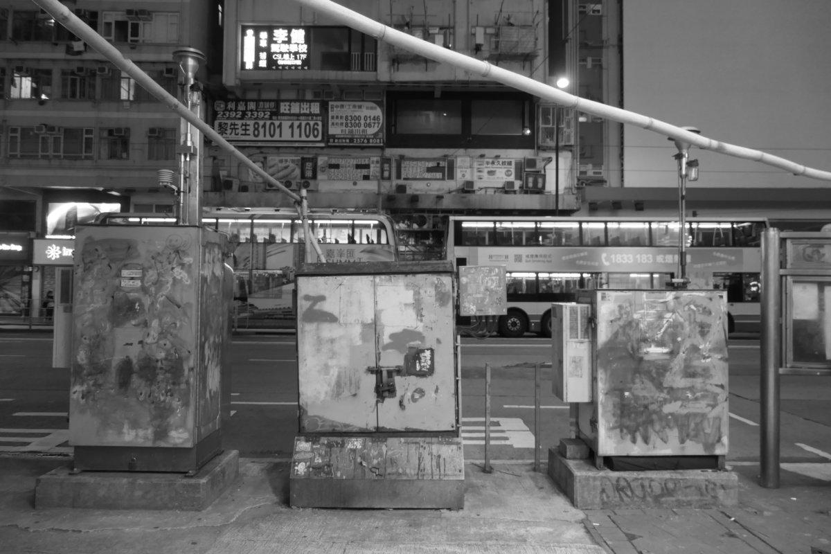 Deleted graffiti, streetside air pollution monitoring stations, Causeway Bay, Hong Kong (photo: John Batten)