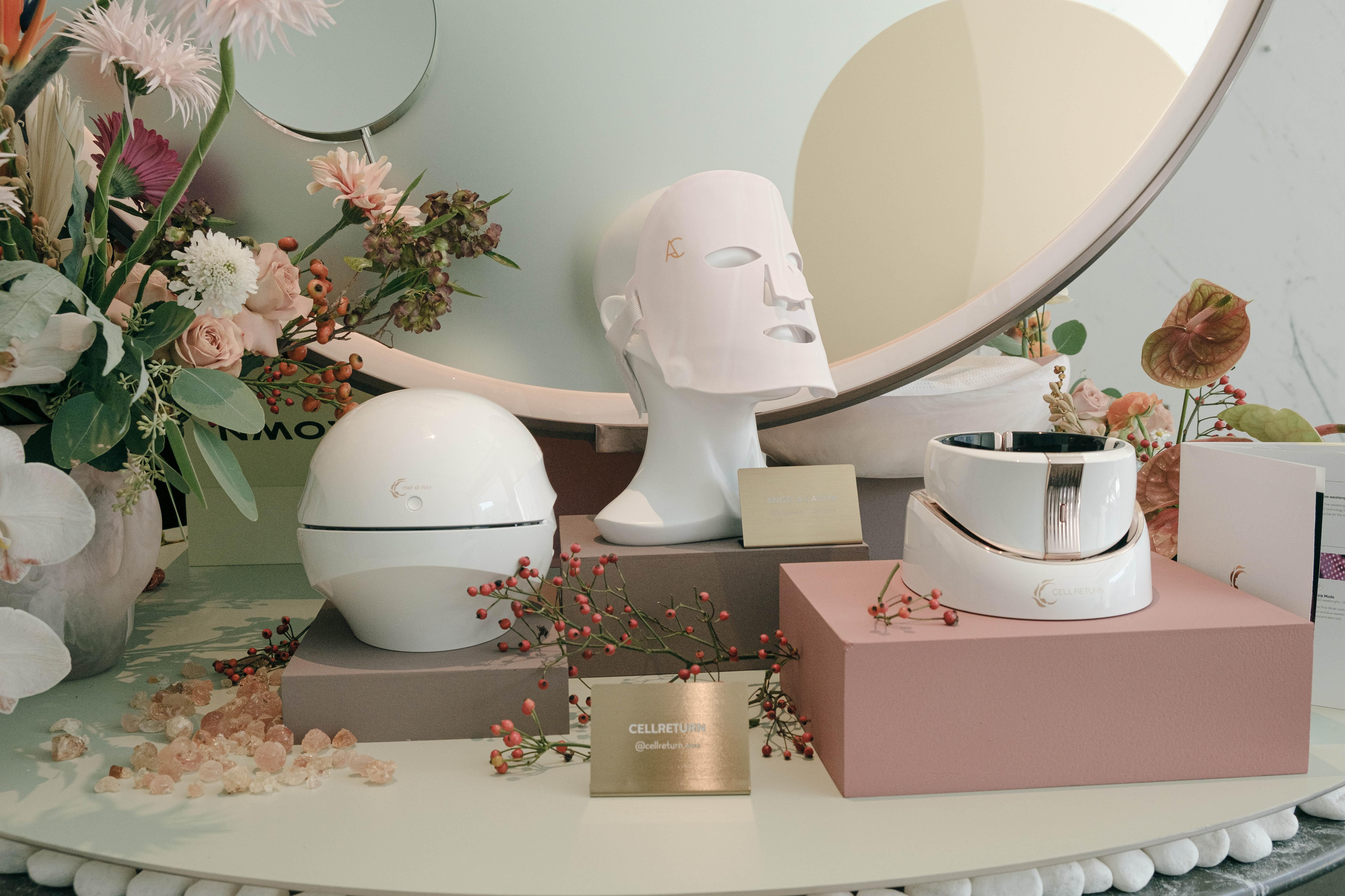 (左起) CELLRETURN Hair A Ray Premium $10,800|Angela Caglia Rose Quartz LED Mask $3,400|CELLRETURN Neckle Ray Plus $7,700