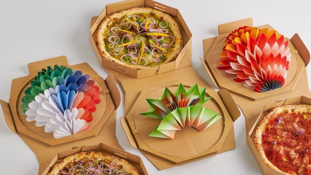 象徵和平的Pizza盒,色彩比現實的灰暗世界,明顯燦爛。