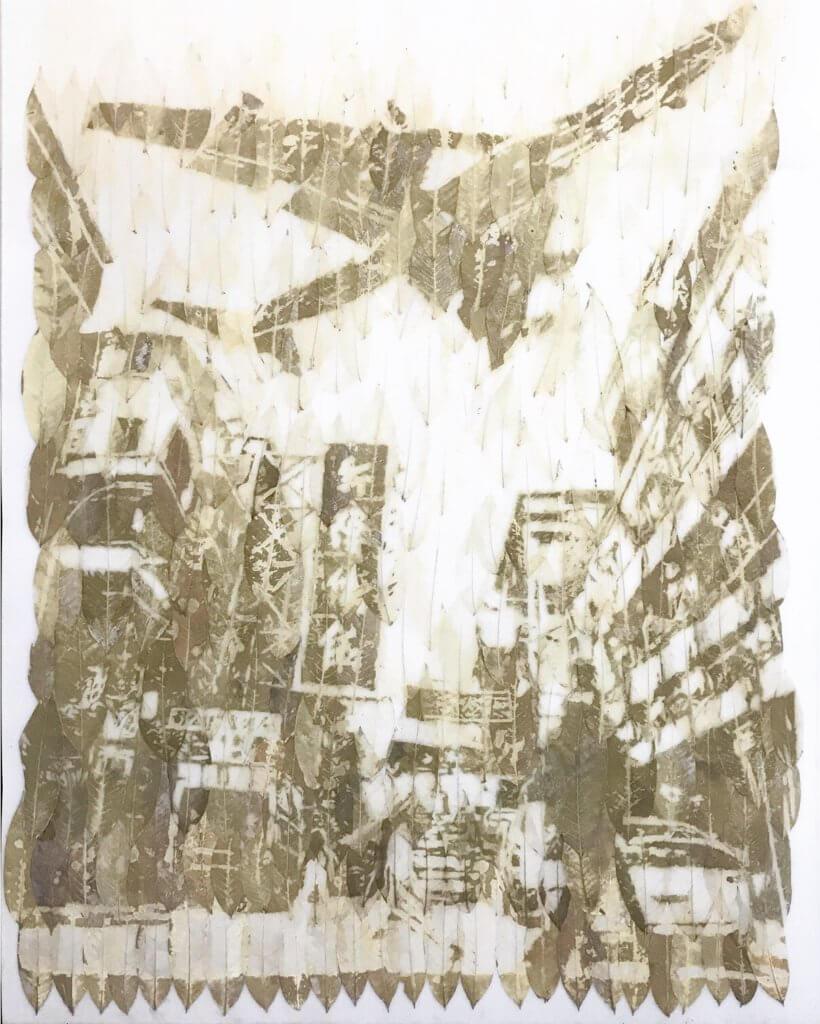 梁洛熙創作的樹葉畫,以落葉砌出舊啟德機場未遷拆時的九龍城街頭景象。