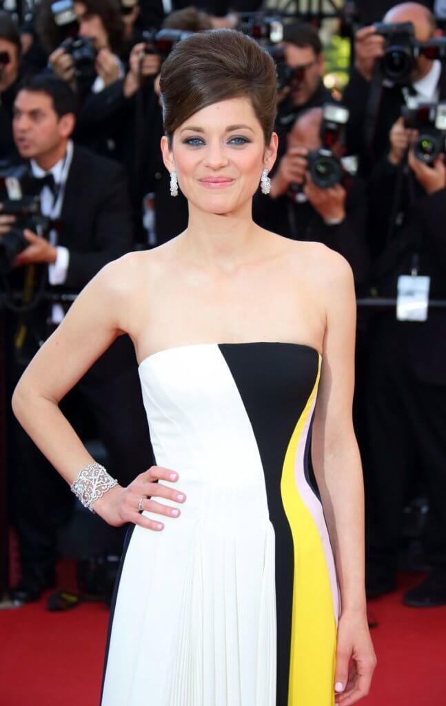 法國演員Marion Cotillard於2013年佩戴蕭邦第一批Green Carpet系列珠寶踏上紅地毯。