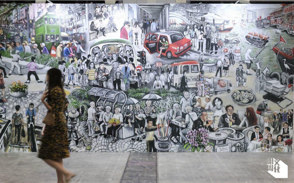 一入場館,便會見一幅巨大畫作,展示香港的眾生相。