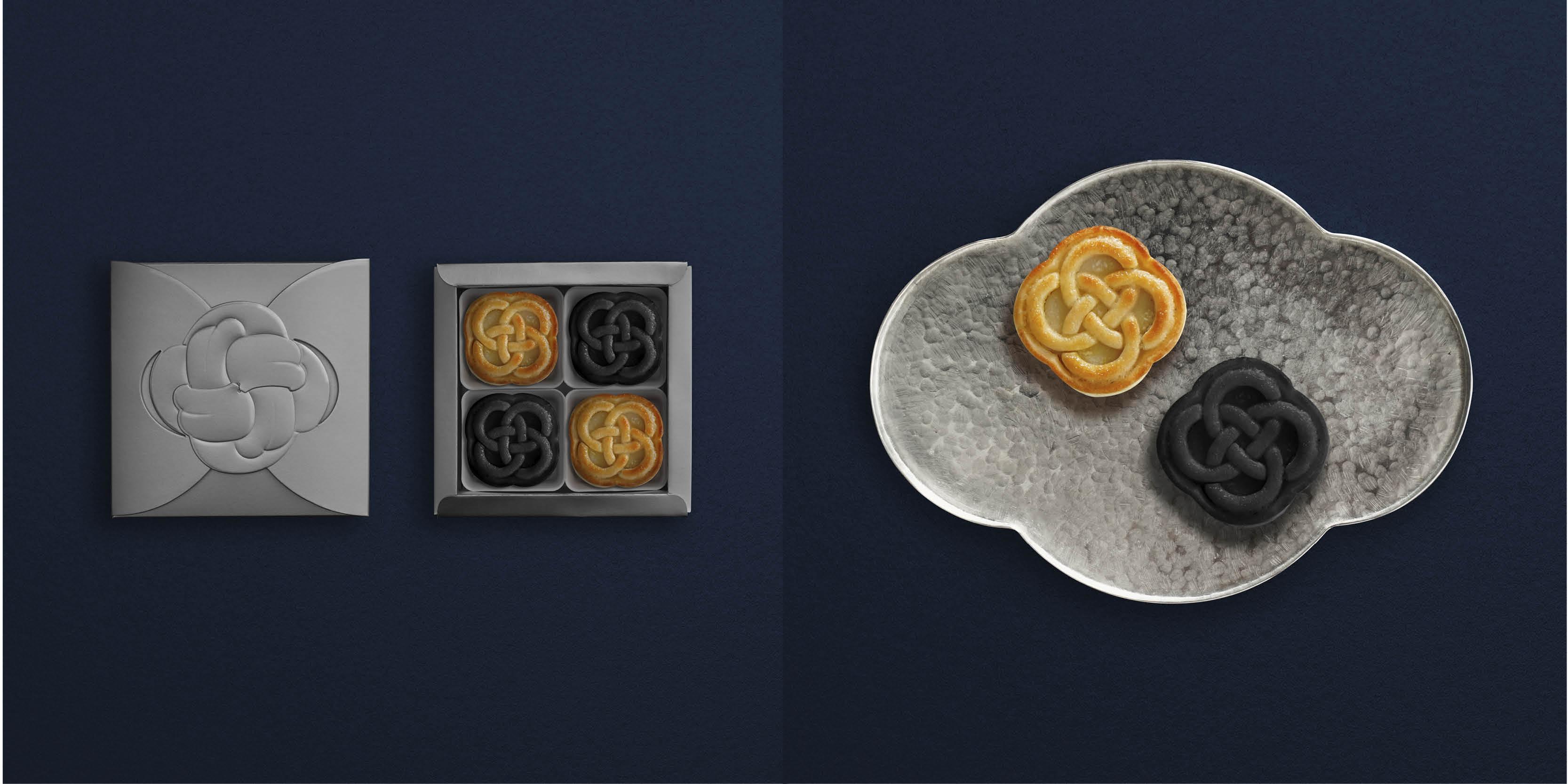 本地純素甜點品牌moono今年推出的月餅禮盒 As The Moon Vegan Mooncake Box Set(一盒四件,$320)  ,繼續標榜百分百純素及無麩質,兩款口味(純素南瓜奶黃月餅、純素奶香烏龍麻糬月餅)均以曲奇皮構成,表面那深邃而精緻的「御結」刻紋,代表着佳節裏的祝福及團圓。包裝雅致之餘,也富有環保概念,採用可循環再造物料的紙盒,配以甘蔗纖維製造的月餅托盤和可完全分解的密封袋盛載。送禮之時也不忘對地球的關顧。