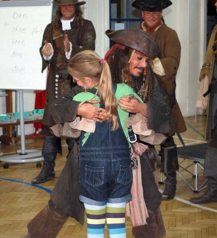EXCLUSIVE: Johnny Depp pays a surprise visit to a London primary school dressed as Jack Sparrow after a letter from girl, 9. The star is currently in south-east London filming the fourth Pirates Of The Caribbean movie On Stranger Tides and arrived at the Meridian Primary School in Greenwich, London, dressed in full character as Captain Jack Sparrow. He made the one-off trip after nine-year-old pupil Beatrice Delap wrote to the star asking for help staging a 'mutiny' against the teachers, as he was filming at the nearby 18th century Old Naval College. Pictured: Johnny Depp Ref: SPL217274 081010 EXCLUSIVE Picture by: Jeff Moore / D Green / Splash News Splash News and Pictures Los Angeles: 310-821-2666 New York: 212-619-2666 London: 870-934-2666 photodesk@splashnews.com