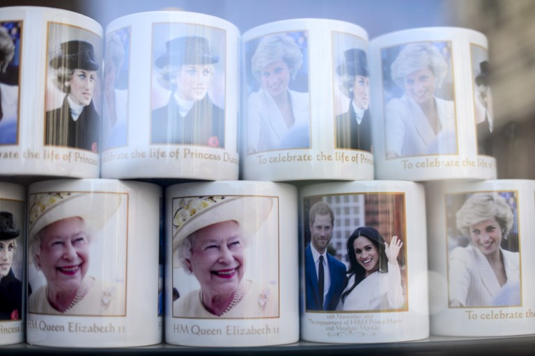 Souvenirs featuring Britain's Prince Harry and his fiance US actress Meghan Markle in a gift shop in Central London, on May 17, 2018. St George's Chapel at Windsor Castle will host the wedding of Prince Harry and Meghan Markle. The town, which gives its name to the Royal Family, is ready for the events as the shops started to sell the official merchandise of the pair. (Photo by Alberto Pezzali/NurPhoto)