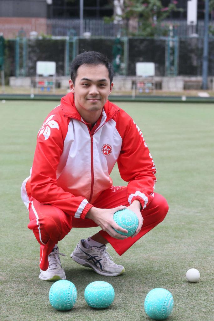 邱子豐是香港草地滾球運動員,去年在世錦賽取得金牌。