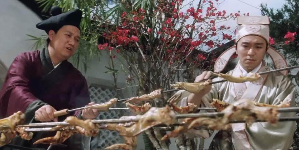曾健明與周星馳在《唐伯虎點秋香》中的一幕,「燒雞翼,我鍾意食。」至今依然是經典。