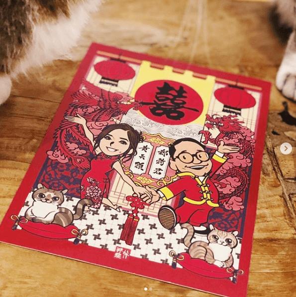 喜帖出自著名本地漫畫家林祥焜手筆,加入一對愛貓外,還有C君的押韻對聯。