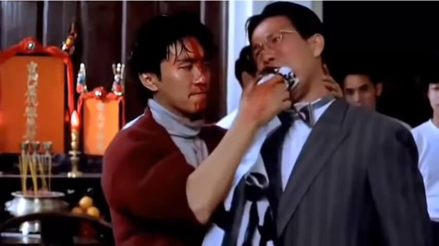 周星馳在電影《新精武門1991》,將紙塞入演漢奸的太保口中,令人難忘。