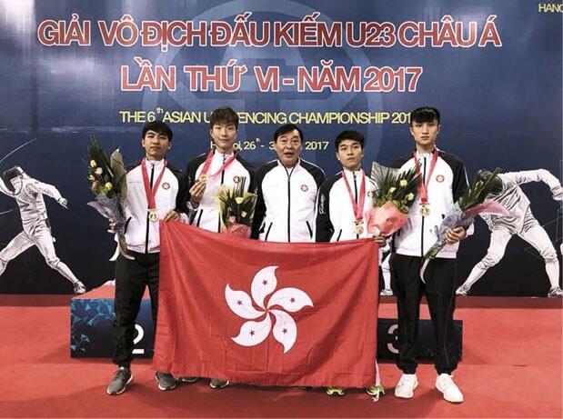 教練汪昌永(中)對張家朗寄予厚望,平時對他的訓練也非常嚴格。